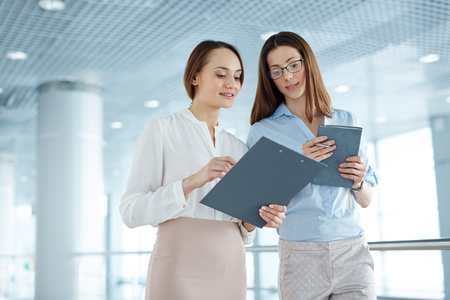 Two businesswomen planning work together at office