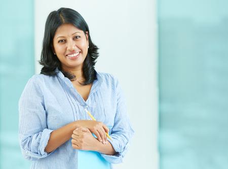 Portrait of Hispanic woman smiling at camera Stock Photo