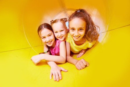 three girls: Portrait of three girls having fun on slide