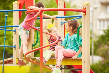 Happy children playing in the playground photo
