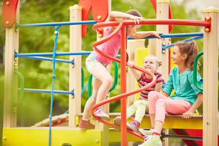 Little girls playing together in the playground photo