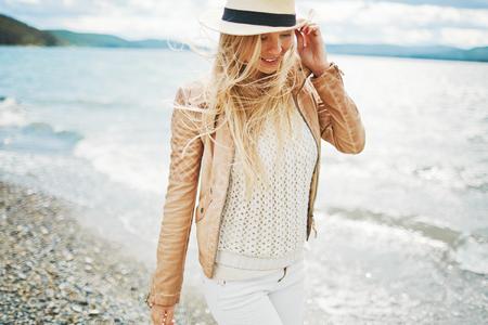 Beautiful girl on the beach alone photo