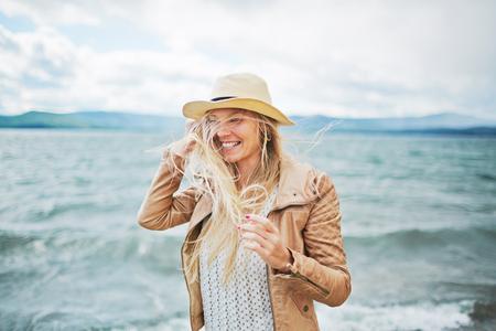 Happy pretty girl on the beach photo
