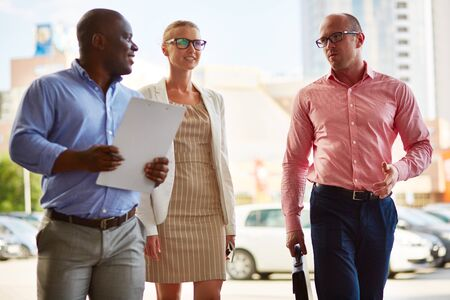 Business team of three walking outdoors photo