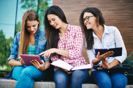 study group: Teenage girls using tablet pc for study