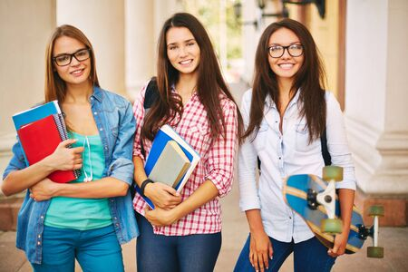 cheerful: Portrait of three attractive students outdoors Stock Photo