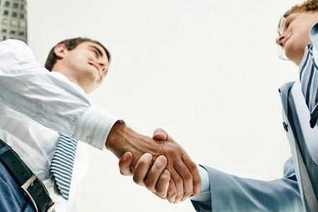 Below view of business people handshaking