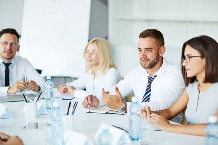 Confident business people interacting at meeting