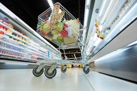 pushcart: Push-cart with fresh products in hypermarket