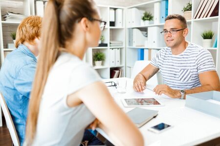 specialists: Young employer interviewing specialists in office Stock Photo