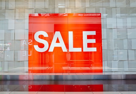 announcing: Red signboard announcing big sale