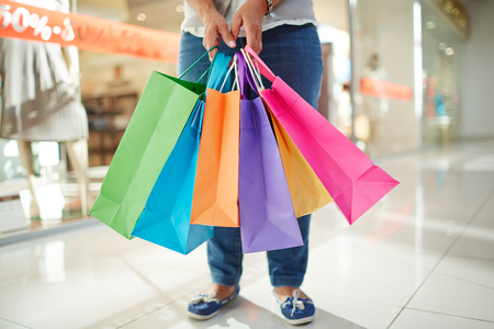 paperbags: Paperbags held by mature shopper