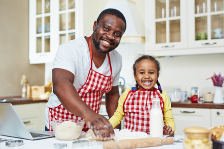 families together: Portrait of happy family of two cooking together Stock Photo