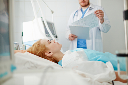 Ill young woman ready for operation in hospital