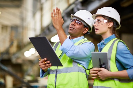 MAle engineer showing the project to his colleague