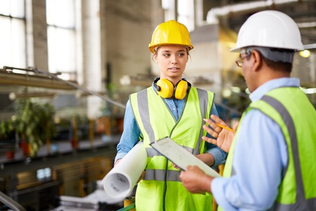 communication industry: Female engineer listening to recommendations of her boss