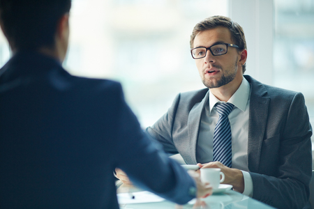 Businessman having an interview with colleague at office photo