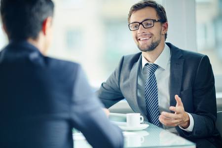 Smiling young businessman discussing during a meeting photo