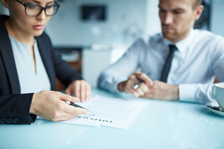new contract: Businesswoman showing new contract to partner
