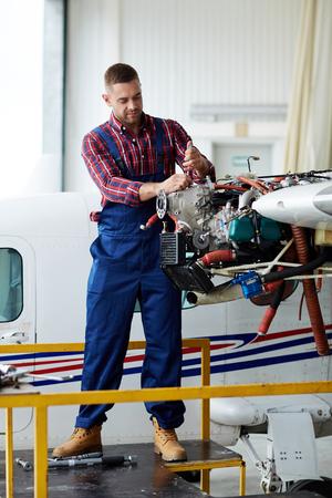 Repairman or mechanic fixing air jet parts