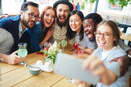 Friends making selfie in outdoor cafe Stock Photo