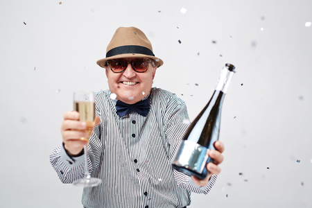 old man happy: Happy senior man with champagne and flute