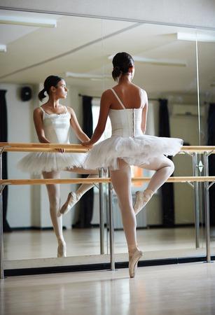 dancers: Pretty girl in tutu dress dancing in front of mirror