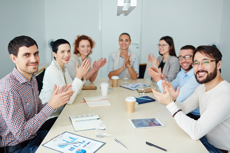 ovation: Business people clapping hands after successful presentation Stock Photo