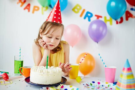sweettooth: Pretty child looking at tasty birthday cake