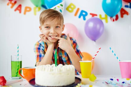 sweettooth: Cute boy tasting yummy birthday dessert Stock Photo