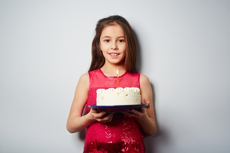 sweettooth: Adolescent girl with dessert looking at camera