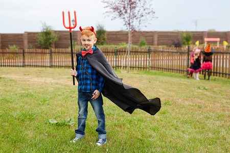 Little boy in costume of devil looking at camera Stock Photo