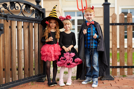 Group of cute children in Halloween costumes Stock Photo