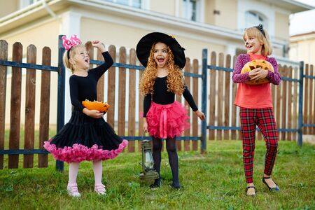 ecstatic: Three ecstatic girls in Halloween costumes Stock Photo