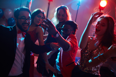 adult entertainment: Ecstatic young people enjoying dance Stock Photo