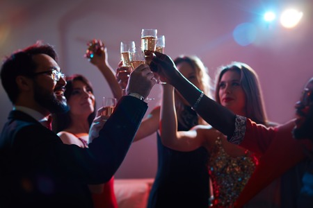 Group of young people toasting with champagne Stock Photo