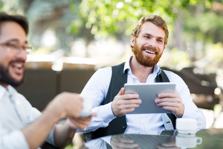 and white collar workers: Happy white collar workers having meeting in outdoor cafe Stock Photo
