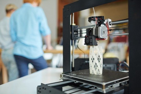 Modern 3d printer with architectural model