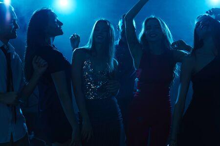 clubber: Group of joyful dancers enjoying party in night club