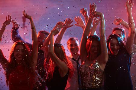 Dancing group enjoying night party