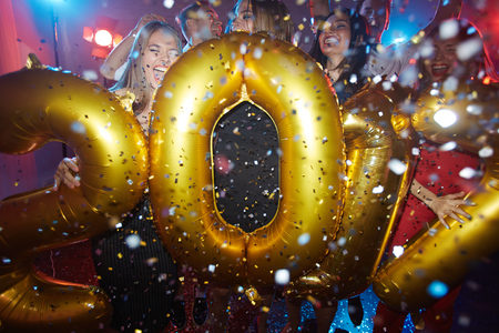 newyear: Group of ecstatic friends celebrating new year