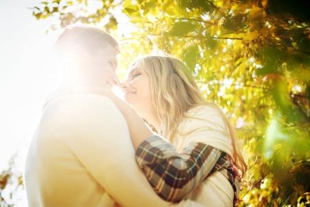 beaming: Two embracing people in beaming sun