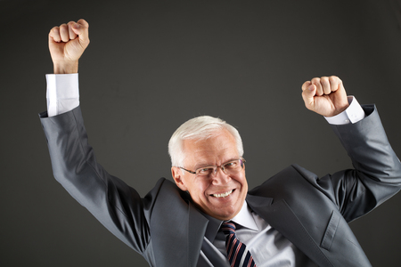 rejoicing: Portrait of rejoicing boss isolated on black Stock Photo