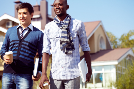 college dorm: Portrait of two higher school students standing outdoors Stock Photo