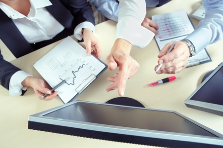 information point: Business team working with computer presentation and finances Stock Photo