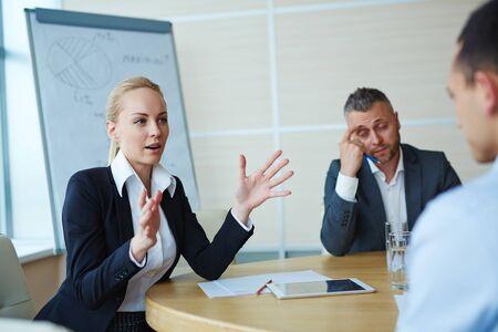 tendencies: Young coach explaining new tendencies in modern market