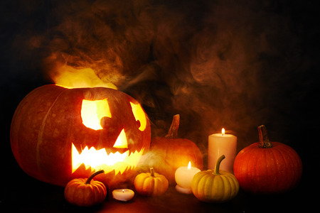 repent: Halloween symbols in darkness covered by mist