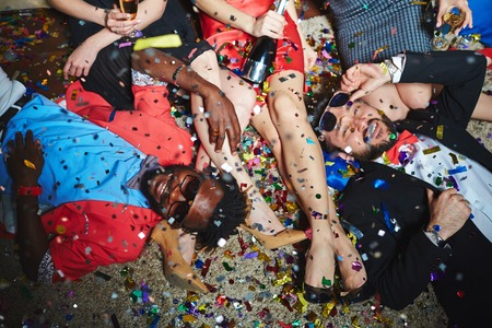 clubber: Posh young friends relaxing at party Stock Photo