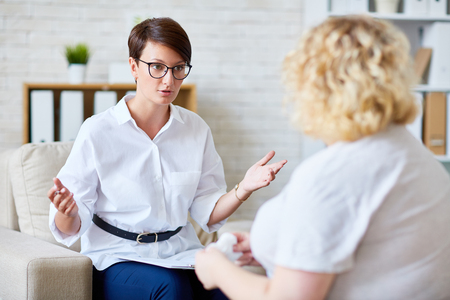 Confident specialist consulting her patient