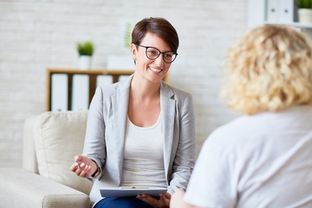 psychiatry: Successful psychologist talking to her patient